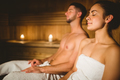 Happy couple enjoying the sauna together at the spa - PhotoDune Item for Sale