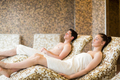 Couple relaxing in the thermal suite at the spa - PhotoDune Item for Sale