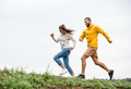Couple jogging on a hike in the countryside