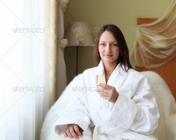 young  woman with glasses of champagne - Stock Photo - Images
