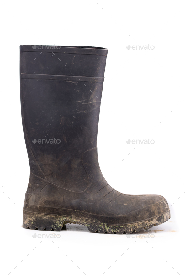 Muddy rubber boot side view isolated on white background - Stock Photo - Images