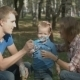 Boy Is Playing Together With His Parents. They Are - VideoHive Item for Sale