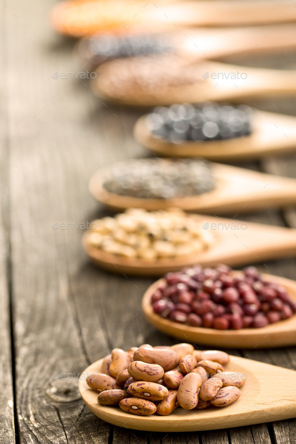 various dried legumes in wooden spoons - Stock Photo - Images