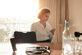 Businesswoman at conference table using mobile phone - PhotoDune Item for Sale