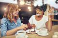 Two pretty young woman enjoying coffee - PhotoDune Item for Sale