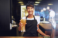 Smiling friendly waitress serving a beer - PhotoDune Item for Sale