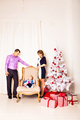 Christmas Family Portrait In Home Holiday Living Room, Baby  With Present Gift Box