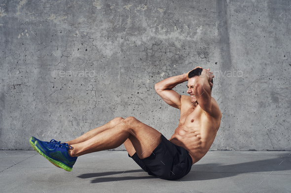 Fitness model exercising sit ups and crunches - Stock Photo - Images