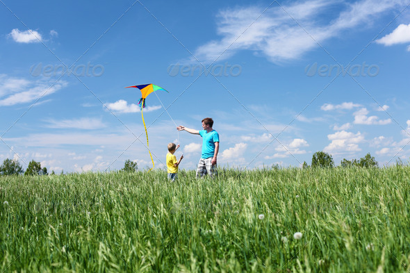 father with son in summer with kite - Stock Photo - Images