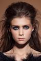 Fashion shiny highlighter on skin, gloss lips make-up and natural eyebrows