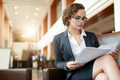 Businesswoman at lobby reading documents - PhotoDune Item for Sale
