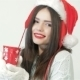 Santa Girl Holding Red Coffee Cup - VideoHive Item for Sale
