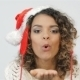 Attractive Lady In Santa Hat Makes Blowing a Kiss - VideoHive Item for Sale