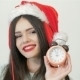Beautiful Girl In Santa Hat Posing With Clock - VideoHive Item for Sale