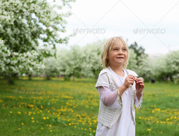 little girl in spring park - Stock Photo - Images
