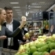 Young People Choosing Apples In The Supermarket - VideoHive Item for Sale