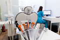 Equipment and dental instruments in dentist's office. Dentist at work - PhotoDune Item for Sale
