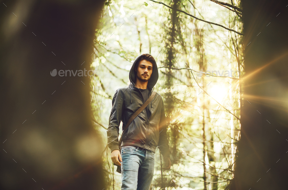 Young man in the forest - Stock Photo - Images