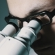 Young Doctor  Looking Through The Microscope - VideoHive Item for Sale