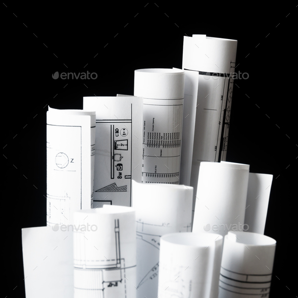 rolls of architecture blueprints and house plans - Stock Photo - Images