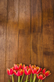 Bouquet of red beautiful flowers on wood desk - PhotoDune Item for Sale