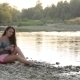 Girl Sitting On The River Bank Of Phone Viewing - VideoHive Item for Sale