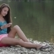Girl Sitting On The River Bank With The Phone - VideoHive Item for Sale