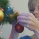 Young Woman Dresses The Christmas Tree 4 - VideoHive Item for Sale