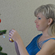 Young Woman Dresses The Christmas Tree 1 - VideoHive Item for Sale