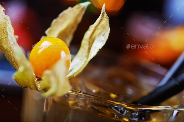bright glass of alcoholic cocktail or lemonade on a table in a bar. soft focus. - Stock Photo - Images