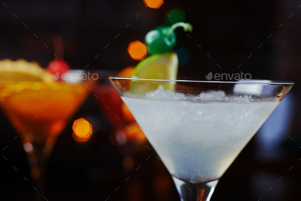 bright beautiful bright glass of alcoholic cocktail or lemonade on a table in a bar. soft focus. - Stock Photo - Images