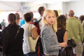 Young blond caucsian woman waiting in line. - PhotoDune Item for Sale