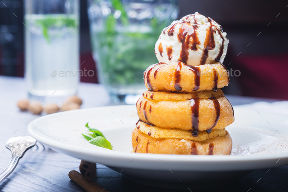 delicious dessert donuts with apples and ice cream on a white plate  - Stock Photo - Images