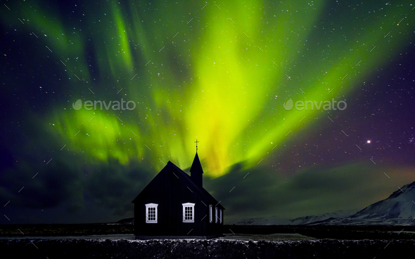 Beautiful Northern light over church - Stock Photo - Images