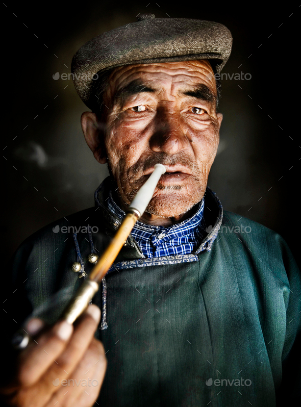 Mongolian Traditional Dress Smoking Pipe Solitude Concept - Stock Photo - Images