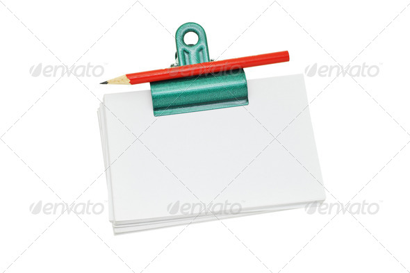 Bulldog clip holding loose memo papers - Stock Photo - Images
