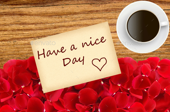 beautiful red rose petals and coffee cup over wood texture close - Stock Photo - Images