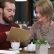 Smiling Couple Reading Menu And Choosing Meal - VideoHive Item for Sale