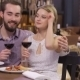 Engaged Couple With Wine Glasses In Restaurant - VideoHive Item for Sale