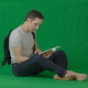 Male Sits on a Floor & Reading a Book Green Screen - VideoHive Item for Sale