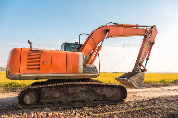 excavator on the country road - Stock Photo - Images