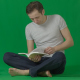 Male Sits on Grass with Book. Green Screen Studio - VideoHive Item for Sale