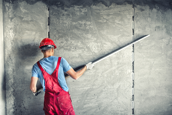 industrial worker with plastering tools renovating a house. builder worker plastering facade - Stock Photo - Images