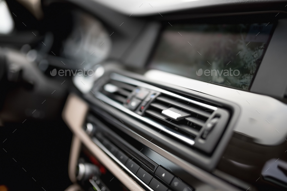 modern car interior with close-up of ventilation system holes - Stock Photo - Images