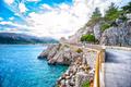 Beautiful Adriatic sea coastline with dramatic sky and sunlight.