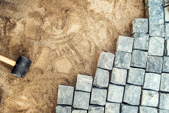 Construction tools and details, pavement installing and rocks - Stock Photo - Images
