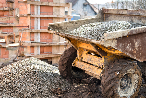 Dumper truck unloading construction gravel, sand and curshed stones - Stock Photo - Images