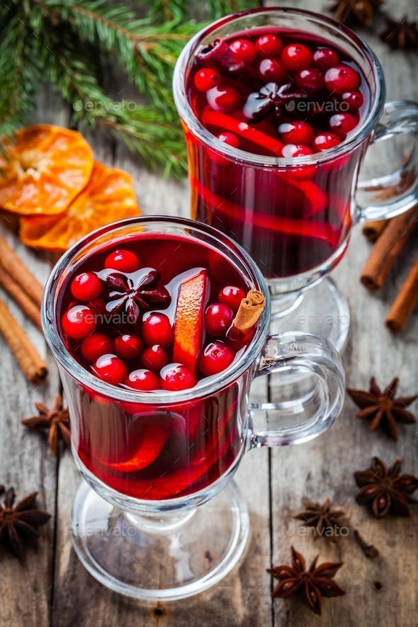homemade mulled wine with orange slices, cranberries, cinnamon and anise - Stock Photo - Images