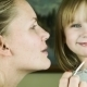 Mother Makes Up Lips To The Daughter, And Then - VideoHive Item for Sale