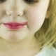 The Little Cute Girl Makes Up Lips With Red - VideoHive Item for Sale